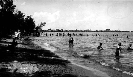 Bathing at South Beach, Gimli, in front of Sparling Camp (Methodist), Gimli, circa 1918. Photo by Kristin Johnson. Archives of Manitoba, Still Images Section. New Iceland Collection. Item Number 365. Negative 11357.